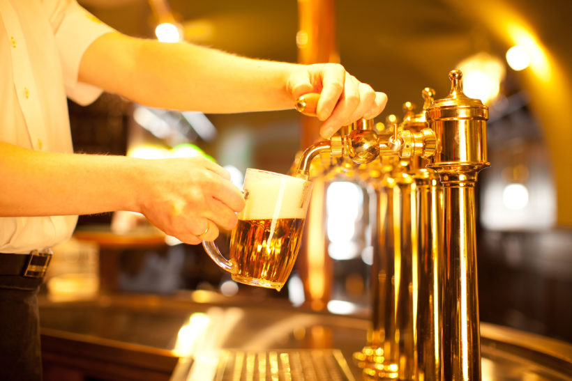 drafting a beer from a golden spigot