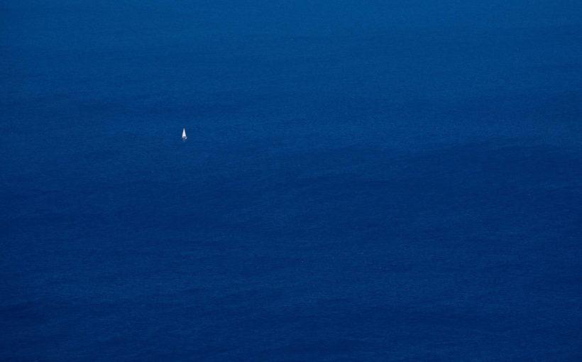 alone yacht near elba island