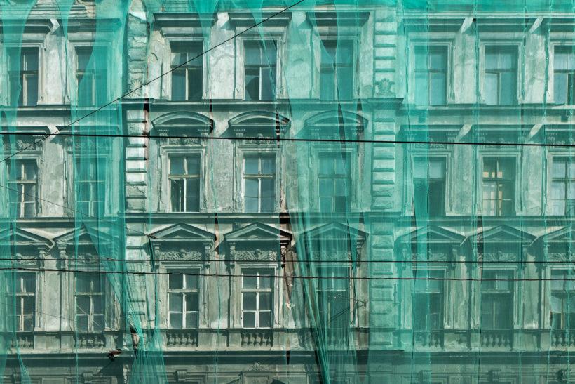 Prague facade under green net