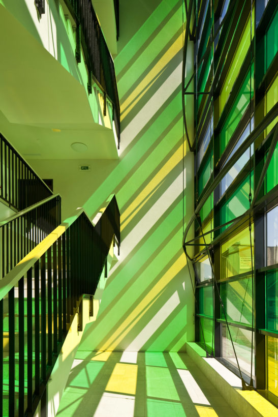 color glass wall in apartment house in Prostějov by Knesl a Kynčl architects